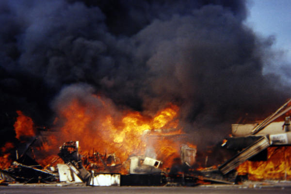 Buildings engulfed in flames during the Los Angeles riots in April 1992. (Madison Richardson)
