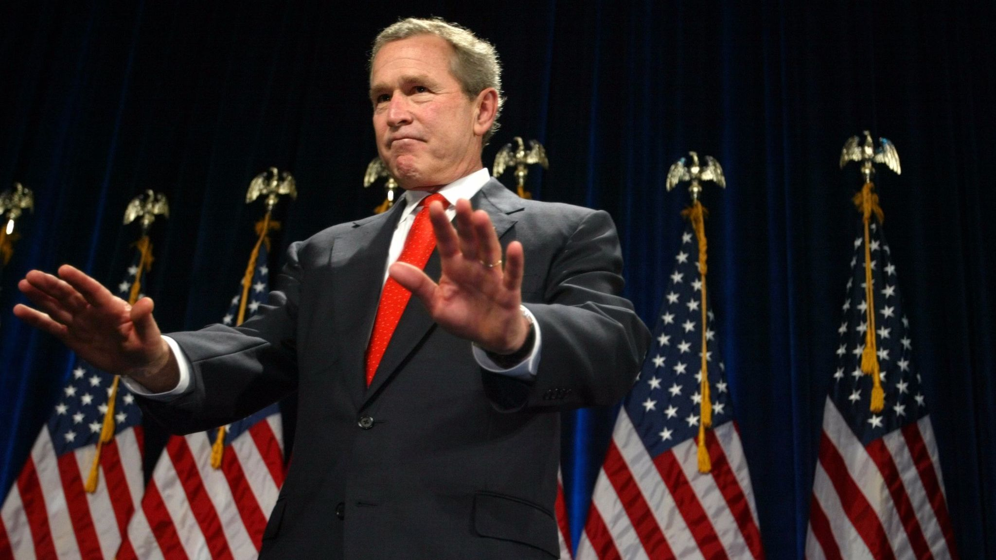 Then-President George W. Bush addresses supporters at a 2004 campaign fundraising dinner in Washington.