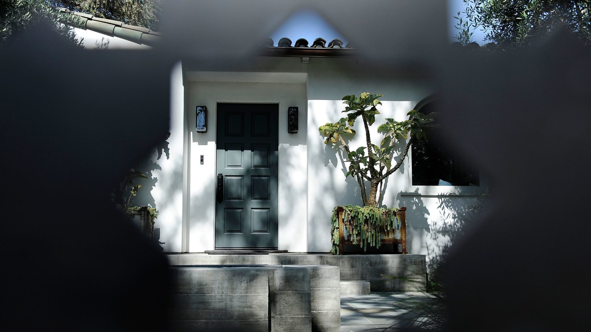 "Collins refers to his Spanish bungalow as the ""50 shades of gray house."""