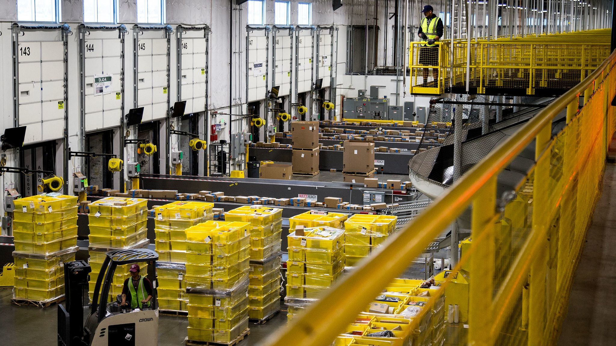 Packages move along a conveyor belt at the Amazon Fulfillment Center in San Bernardino