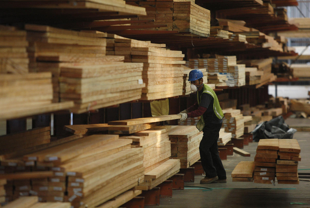 Forklift operator Richard Gascon builds an order of cedar boards in a warehouse with a large inventory of wood at Jones Wholesale Lumber Co. in Lynwood.