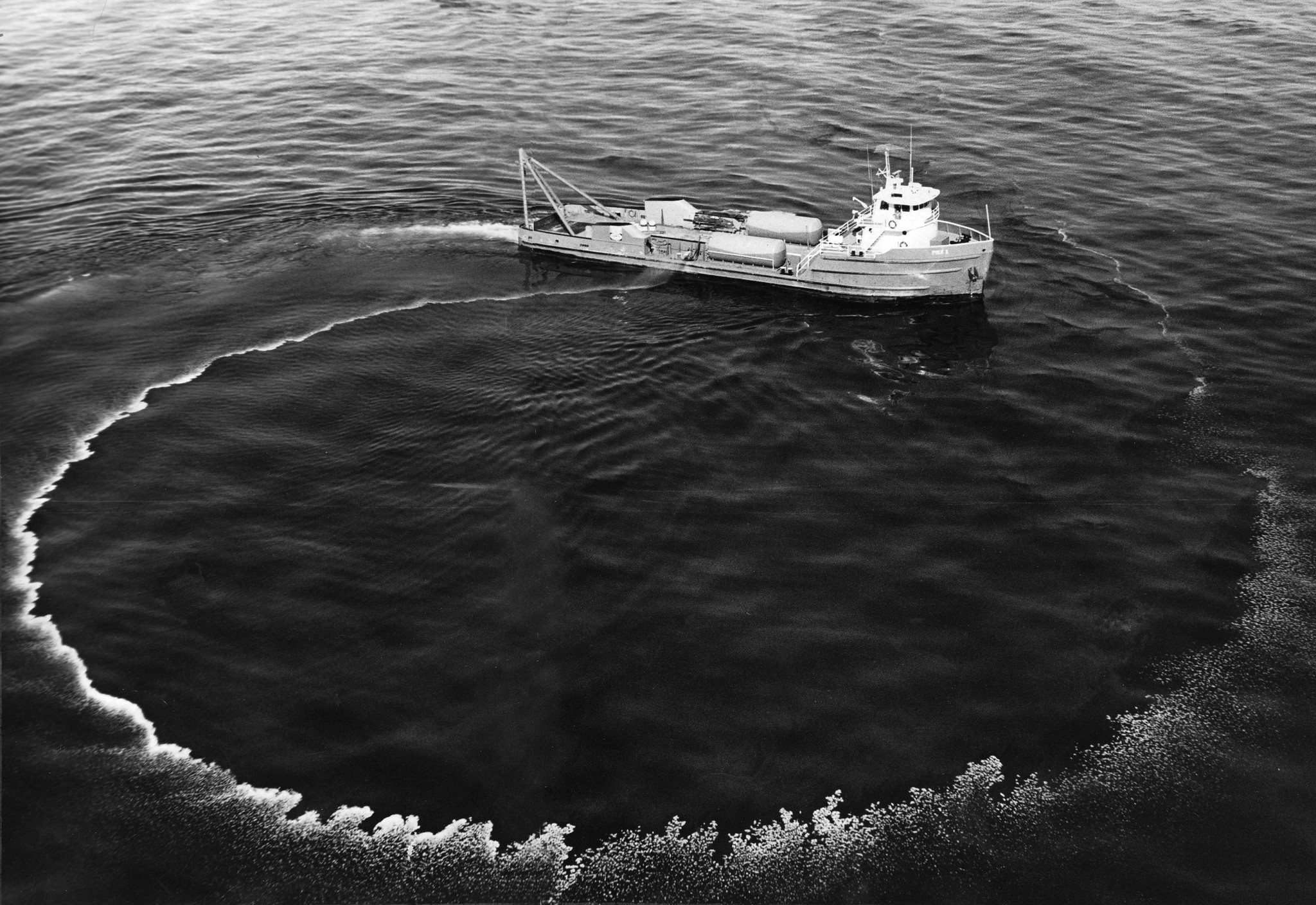 A 140–foot workboat sprays chemicals to disperse the slick that coated the coastal waters and eventually stretched 35 miles from Rincon Point, on the Santa Barbara–Ventura County line, to Goleta.