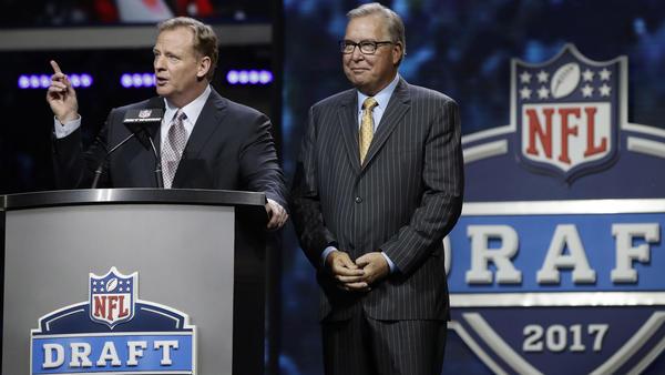 NFL commissioner Roger Goodell, left, and former Philadelphia Eagles quarterback Ron Jaworski address the crowd in Philadelphia before the start of the NFL draft's second round. (Matt Rourke / Associated Press)