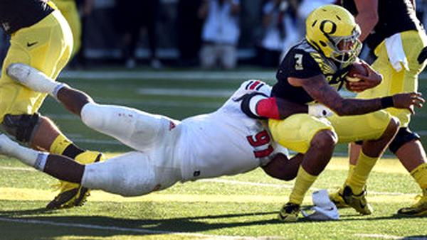 Eastern Washington defensive end Samson Ebukam brings down Oregon quarterback Vernon Adams Jr. during a game in 2015. (Steve Dykes / Getty Images)
