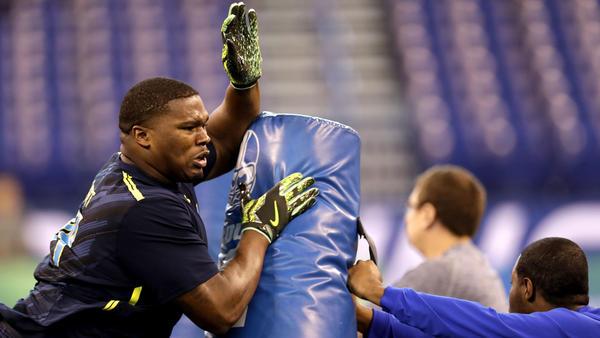 Tulane defensive lineman Tanzel Smart participates in a drill at the NFL combine in March. (David J.Phillip / Associated Press)