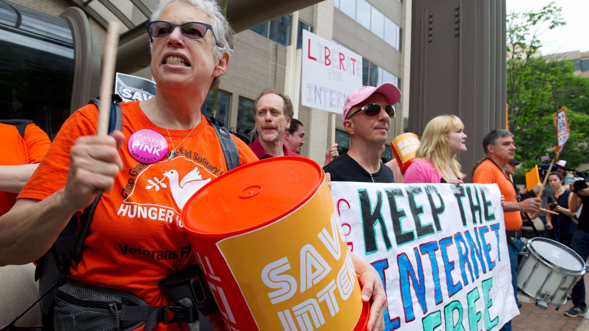 Protesters hold a rally to support net neutrality outside the Federal Communications Commission's headquarters in Washington, D.C., on May 15, 2014.