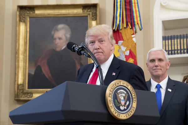 A portrait of former President Jackson hangs on the wall behind President Trump, accompanied by Vice President Mike Pence, as he speaks in the Oval Office on March 31. (Andrew Harnik / Associated Press)