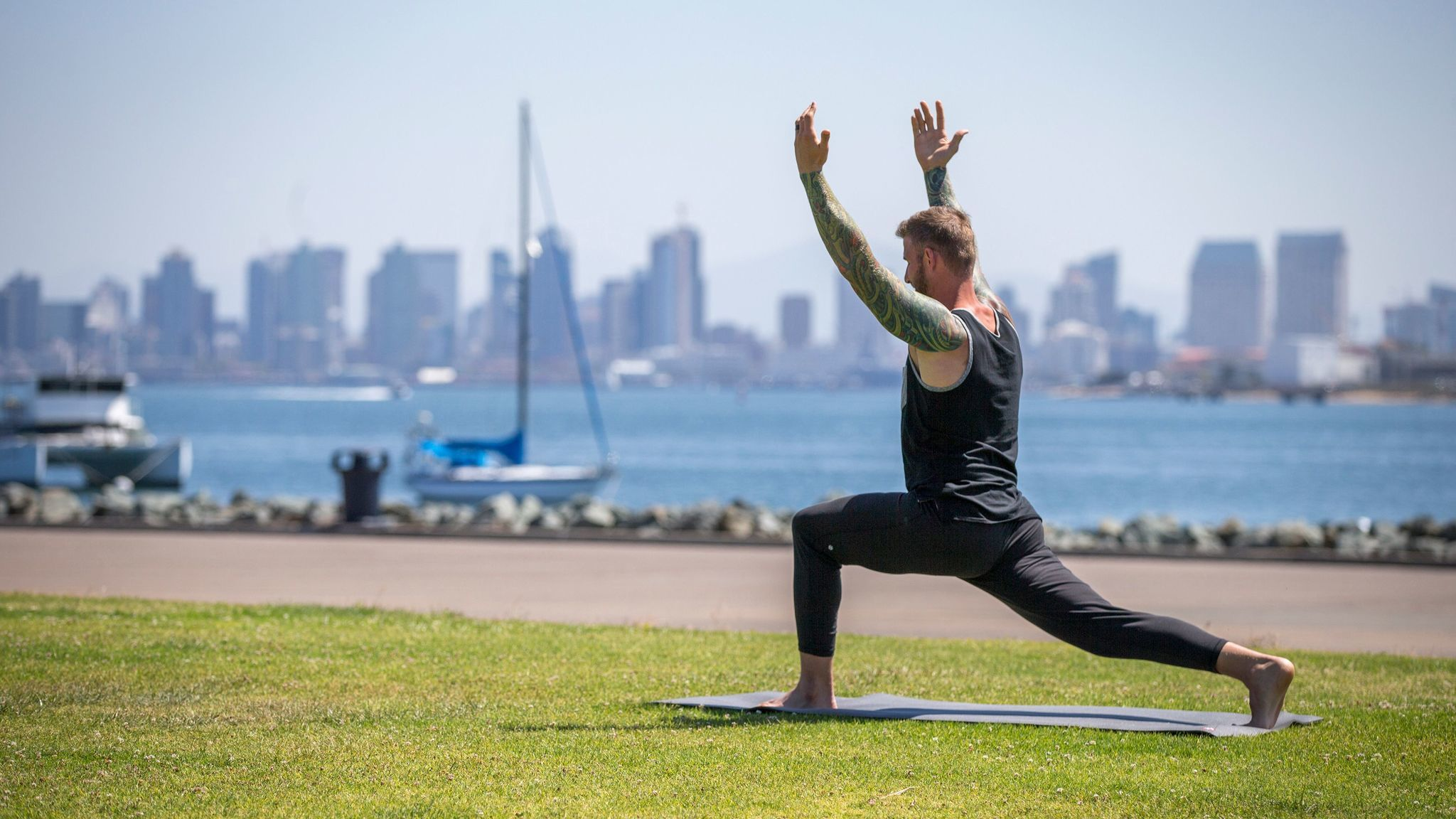 Yoga, against a scenic San Diego backdrop.