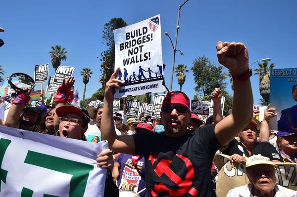 May Day protesters march against President Trump's immigration policy in Los Angeles (Frederic J. Brown/Getty Image)