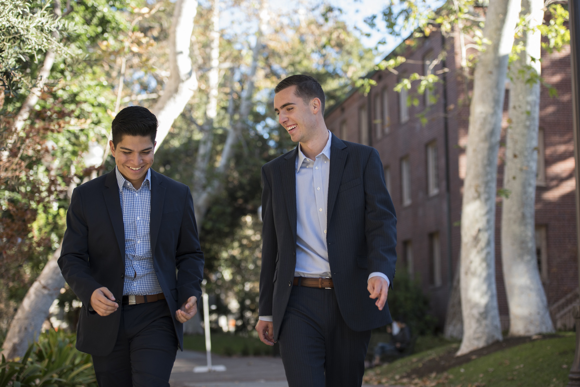 Edwin Saucedo, left, walks across campus with Austin Dunn, student body vice president and incoming president. Saucedo said he hopes Dunn will continue the momentum they have built on numerous campus issues.