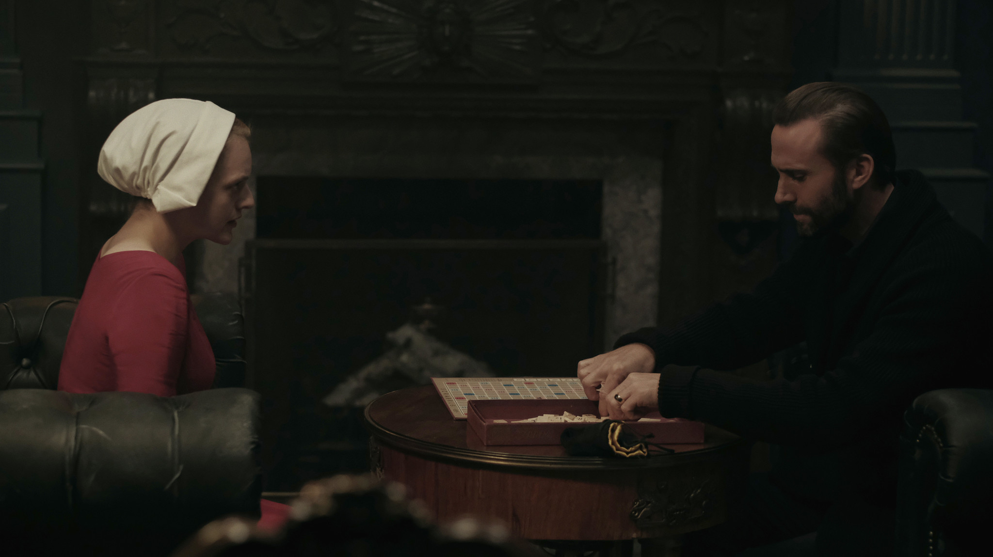"""Elisabeth Moss and Joseph Fiennes play a monumental game of Scrabble in """"The Handmaid's Tale."""""""