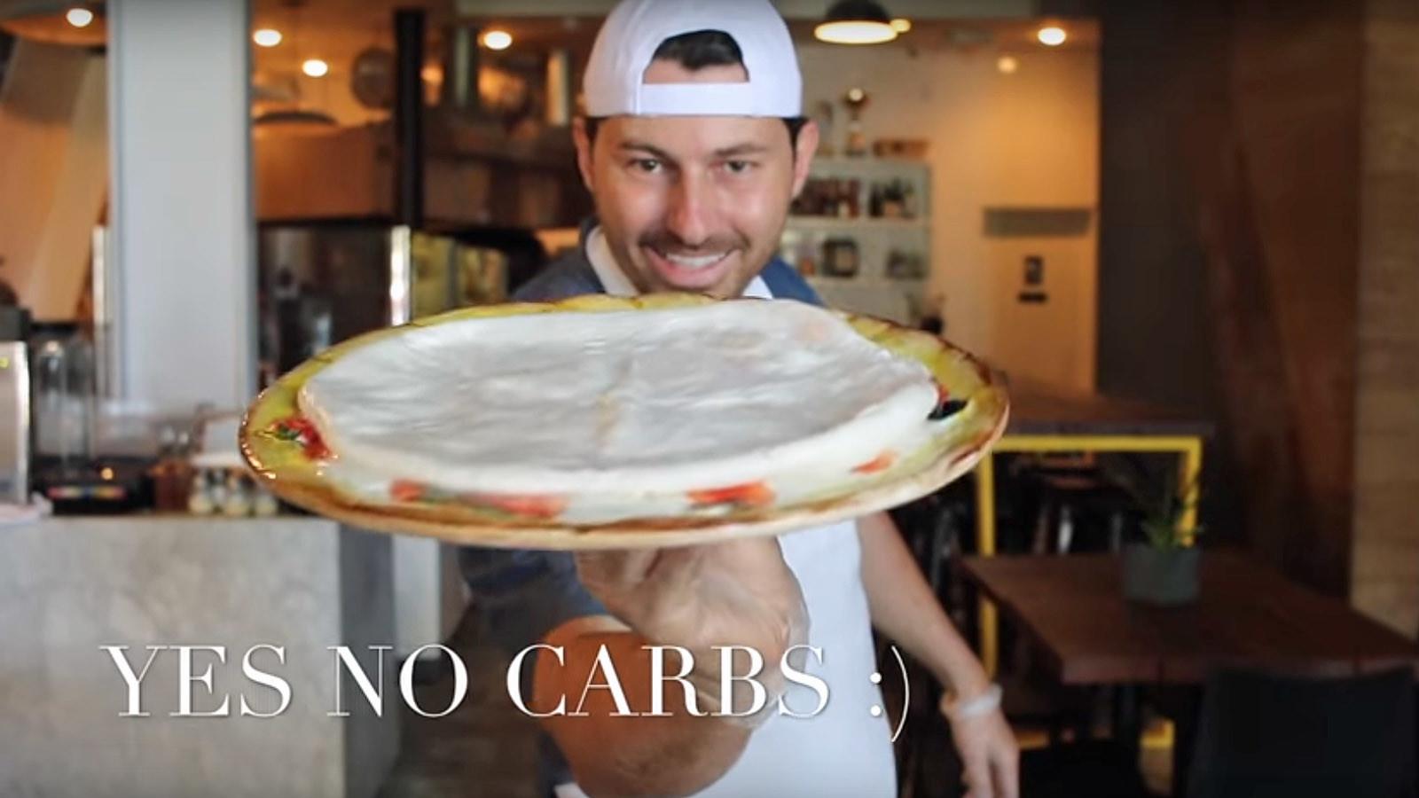 Chef Vito Iacopelli shows off his Mo-Pizza creation.
