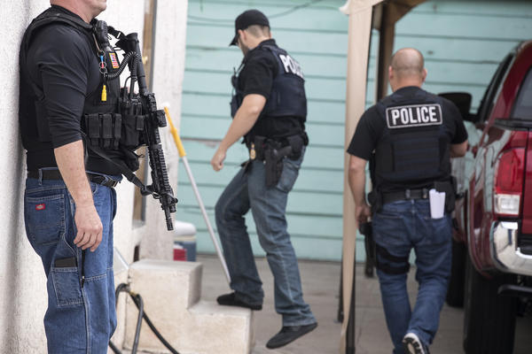 An Immigration and Customs Enforcement fugitive operations team surrounds a Montebello home where a 47-year-old Mexican national lives with his family.