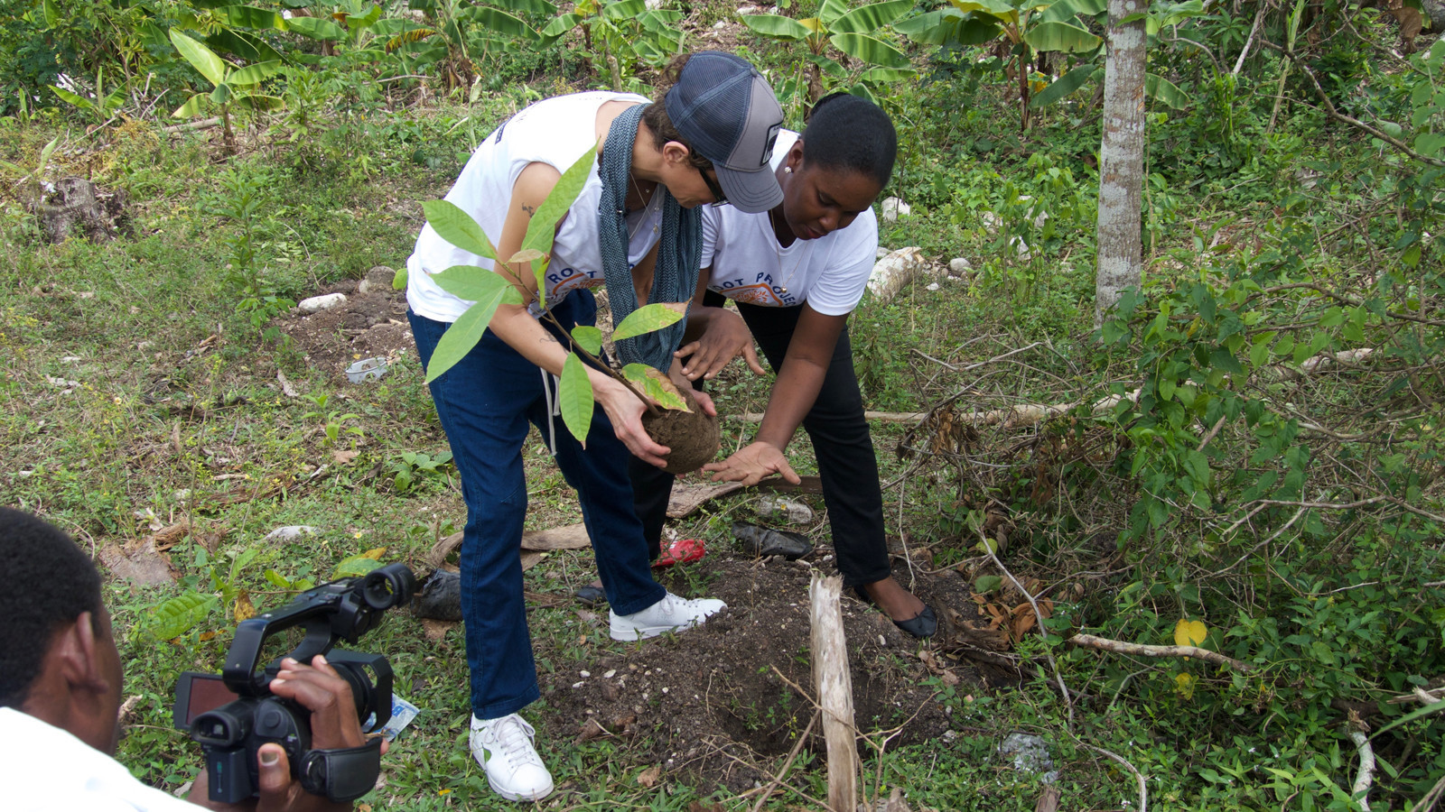 Chef Dominique Crenn, left, plants trees in Haiti as part of the Root Project.