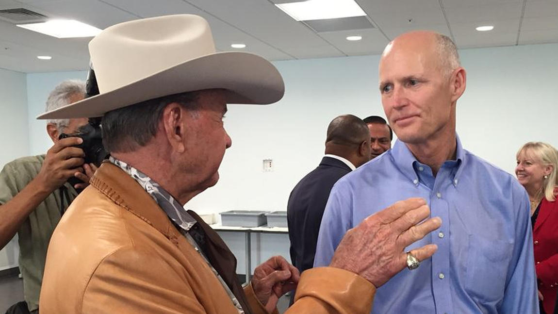 Ron Bergeron, left, the Broward County entrepreneur, land developer and member of the Florida Fish and Wildlife Conservation Commission. At right, Florida Gov. Rick Scott. They were talking at Rick Case Kia in Sunrise after Scott made an appearance there