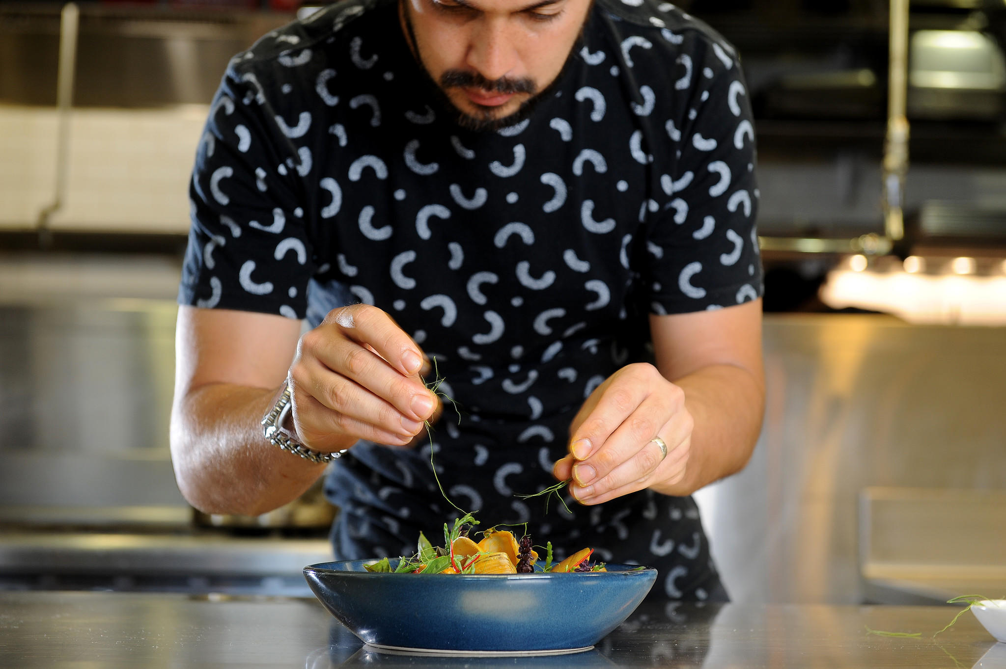 Louis Tikaram, the young Australian chef at E.P. & L.P., makes turmeric and coconut curry with clams and sea beans. (Christina House / For The Times)