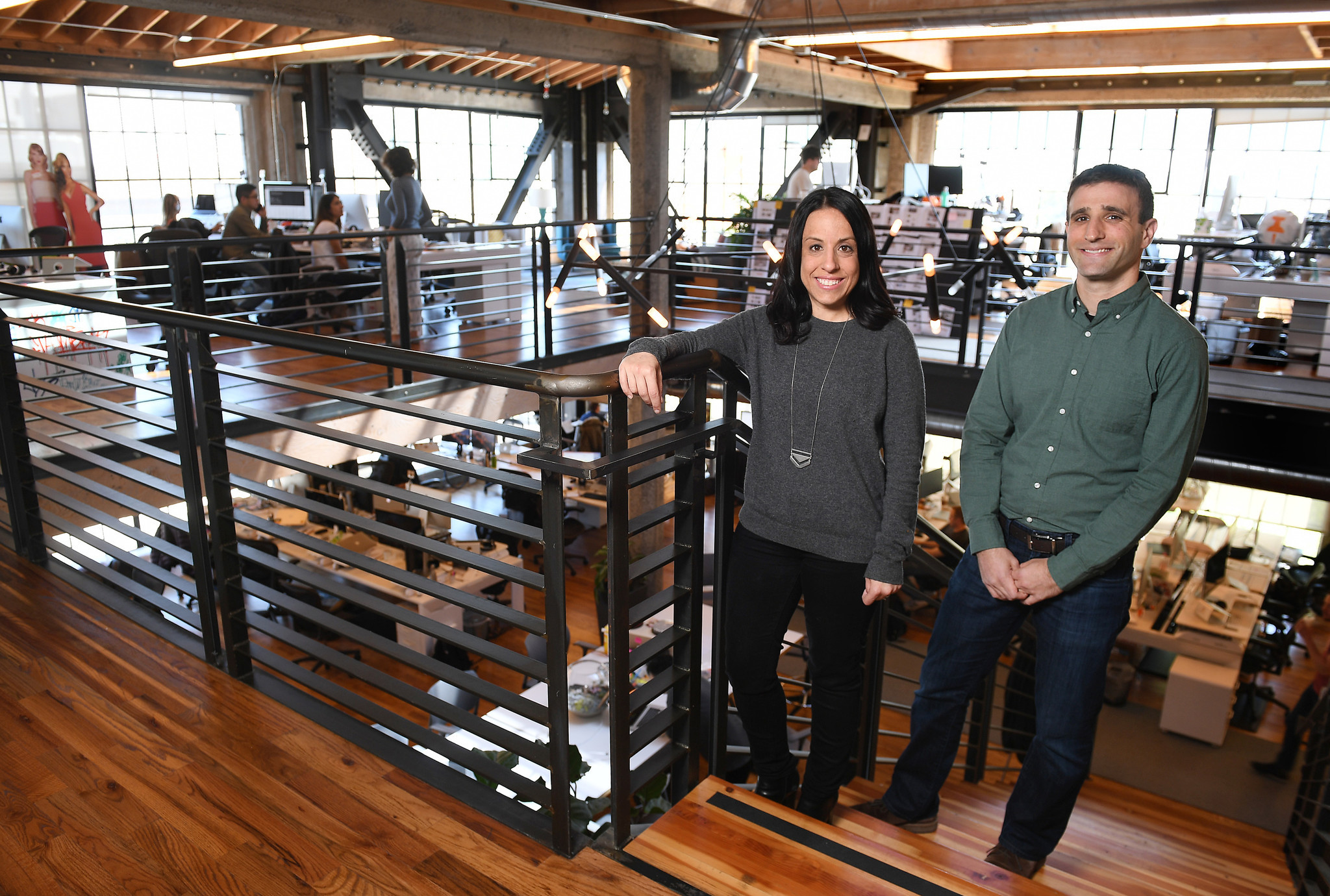 Katie Biber, center, former general counsel for Mitt Romney, and Steven Siger, right, who worked for President Obama, are now attorneys at Thumbtack in San Francisco.