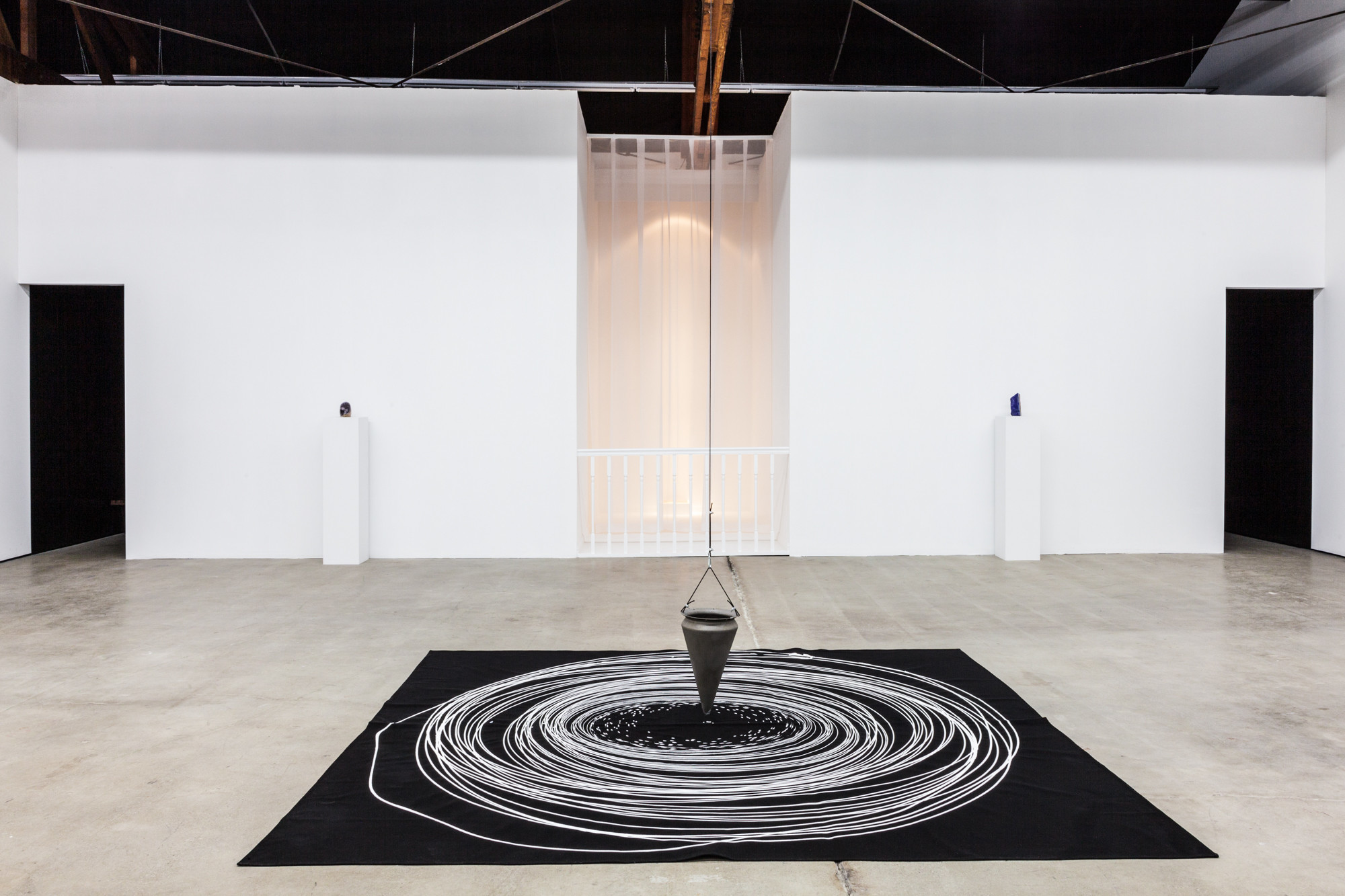 "Michael Carter's pendulum painting, ""#54 15th (Basilisk),"" which was made on-site for the exhibition."