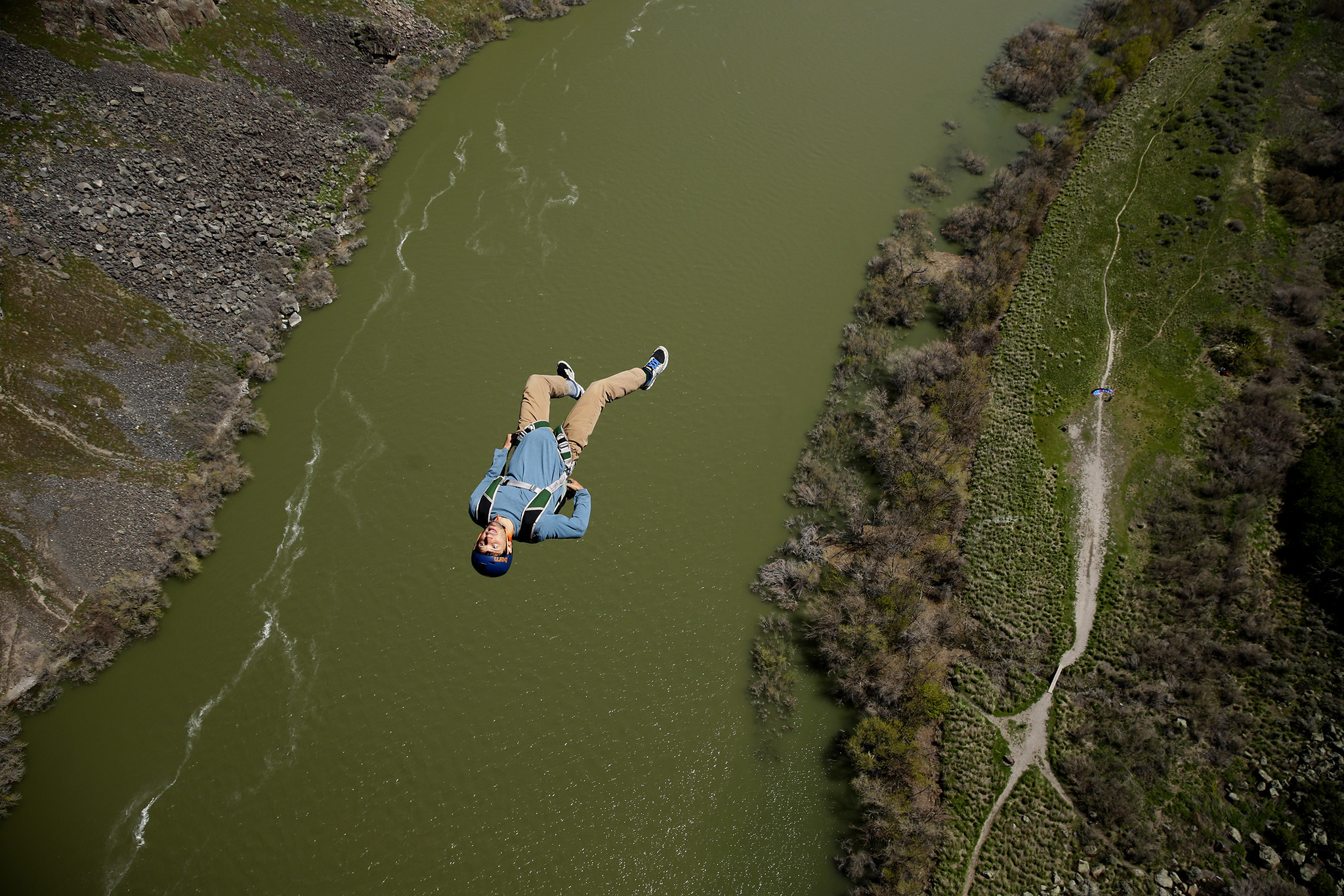 A base jumper leaps from the Perrine Bridge above the Snake River, where one can jump without a permit.
