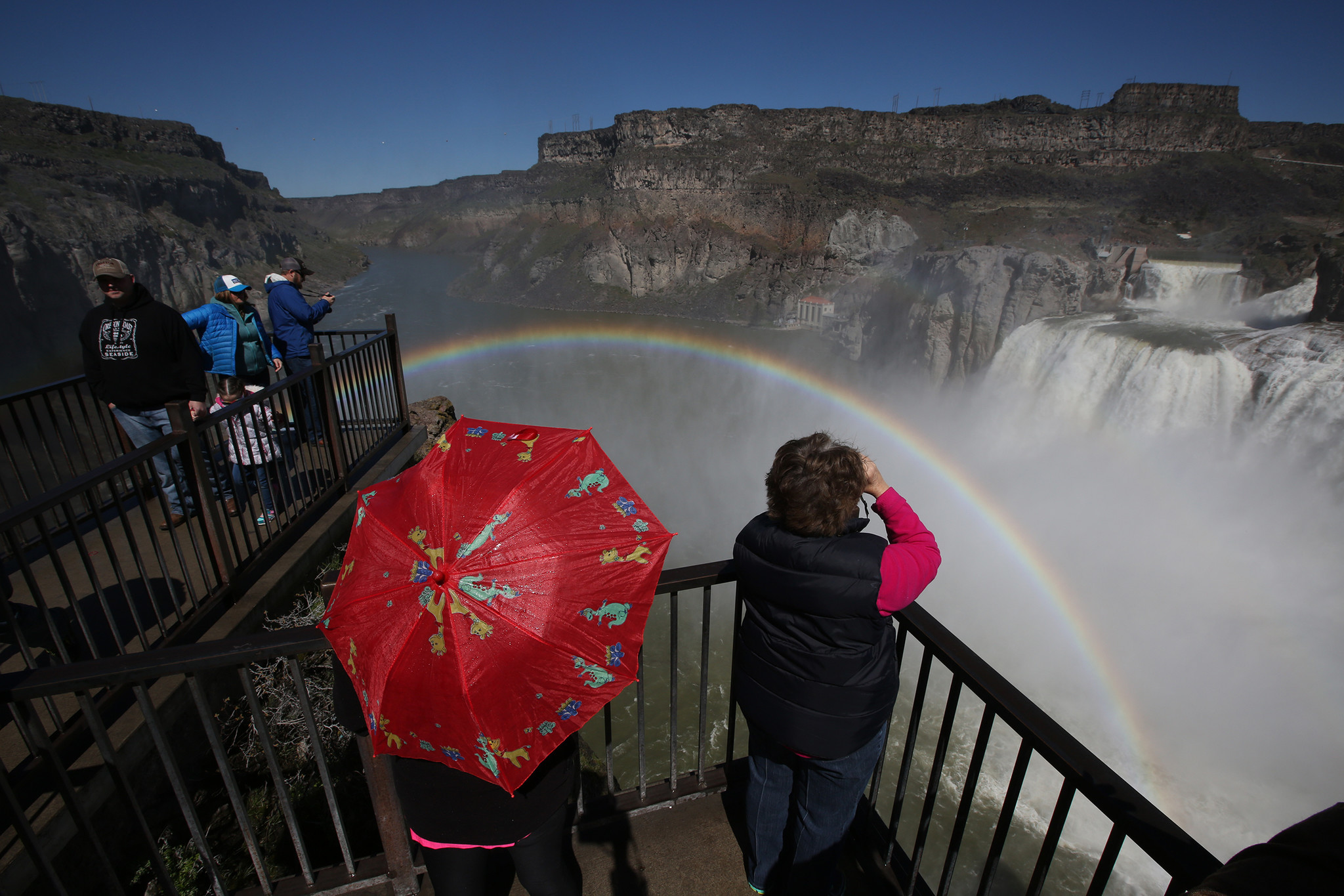 Visitors view a rainbow in the mist from Shoshone Falls on the Snake River.