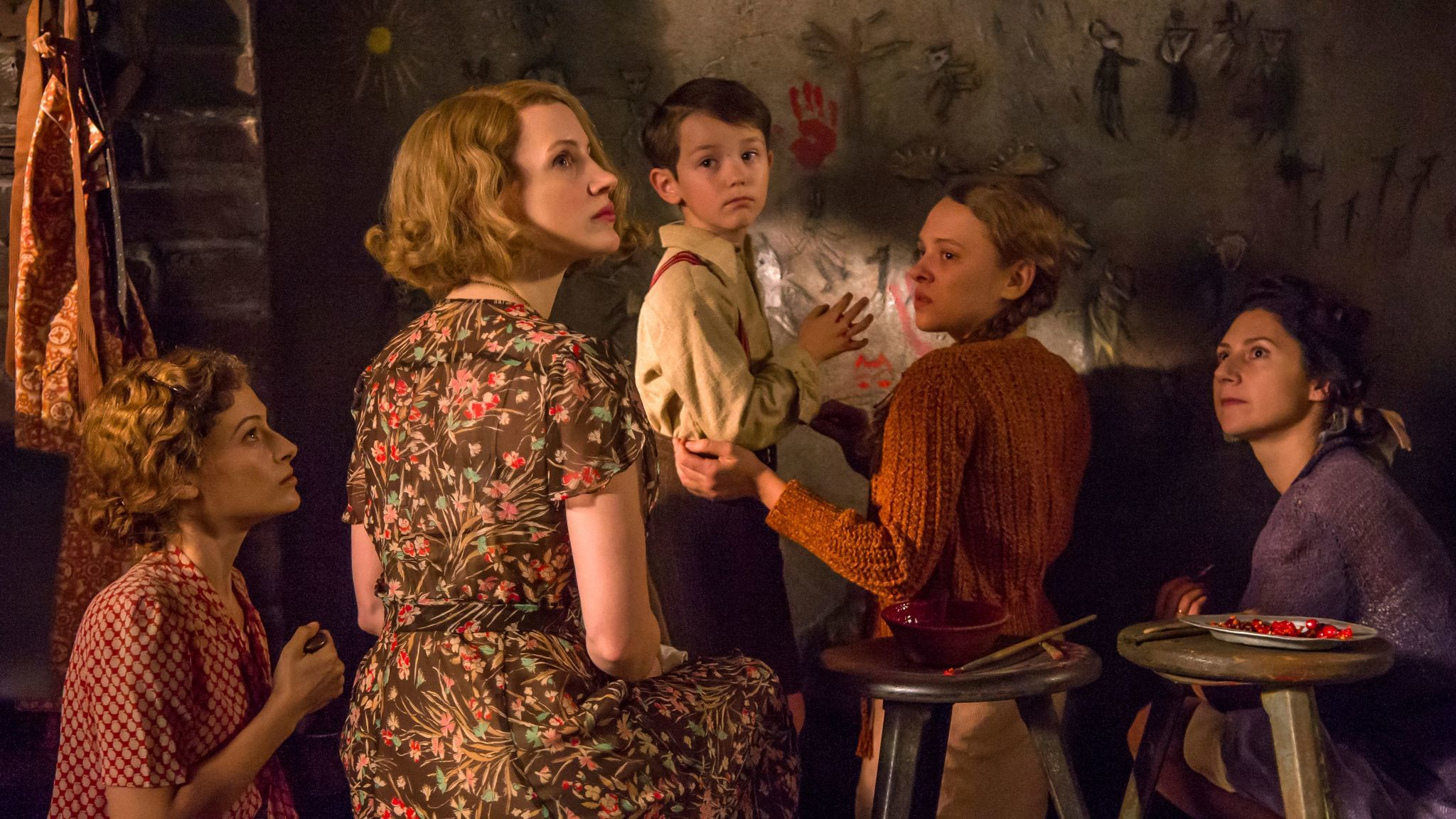 "In the fact-based movie ""The Zookeeper's Wife,"" Jessica Chastain, second from left, portrays the title character. Also pictured, from left: Efrat Dor, Timothy Radford, Shira Haas and Martha Issova."