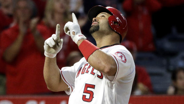 Angels rally for four in ninth to tie score, but Astros win game 7-6 in 10 innings