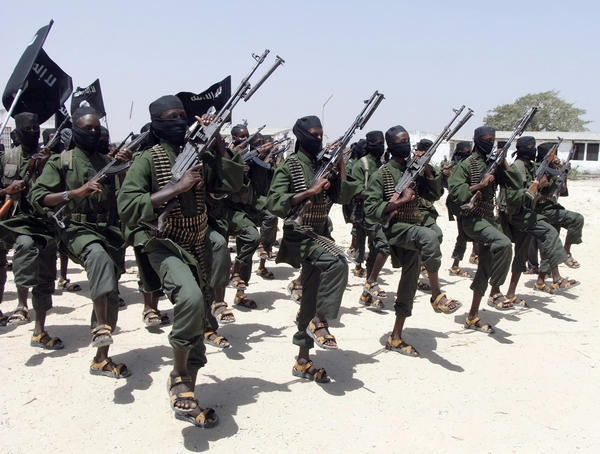 Shabab fighters perform military exercises in Somalia. (Farah Abdi Warsameh / Associated Press)
