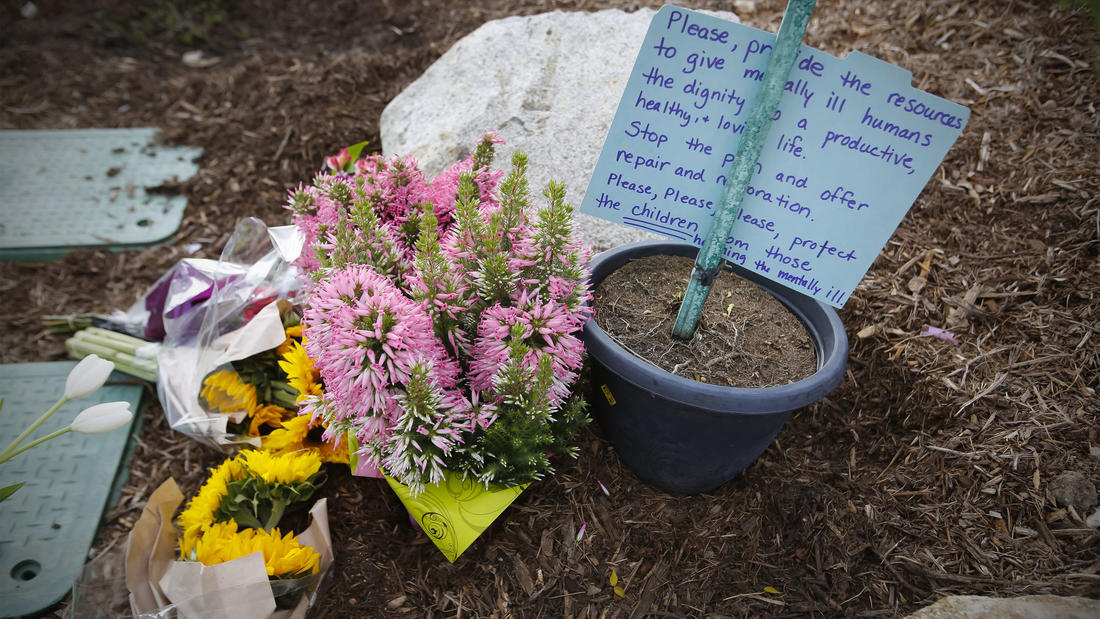 A memorial of flowers is starting to grow in front of Torrey Pines High School