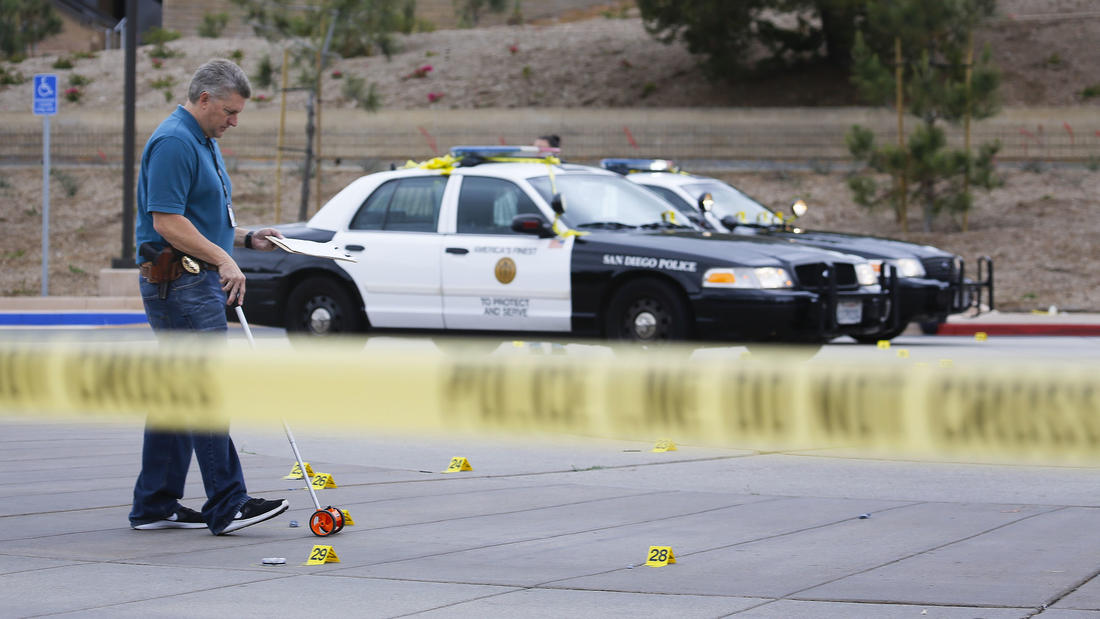 A member of the San Diego Police Department investigates and documents the scene.