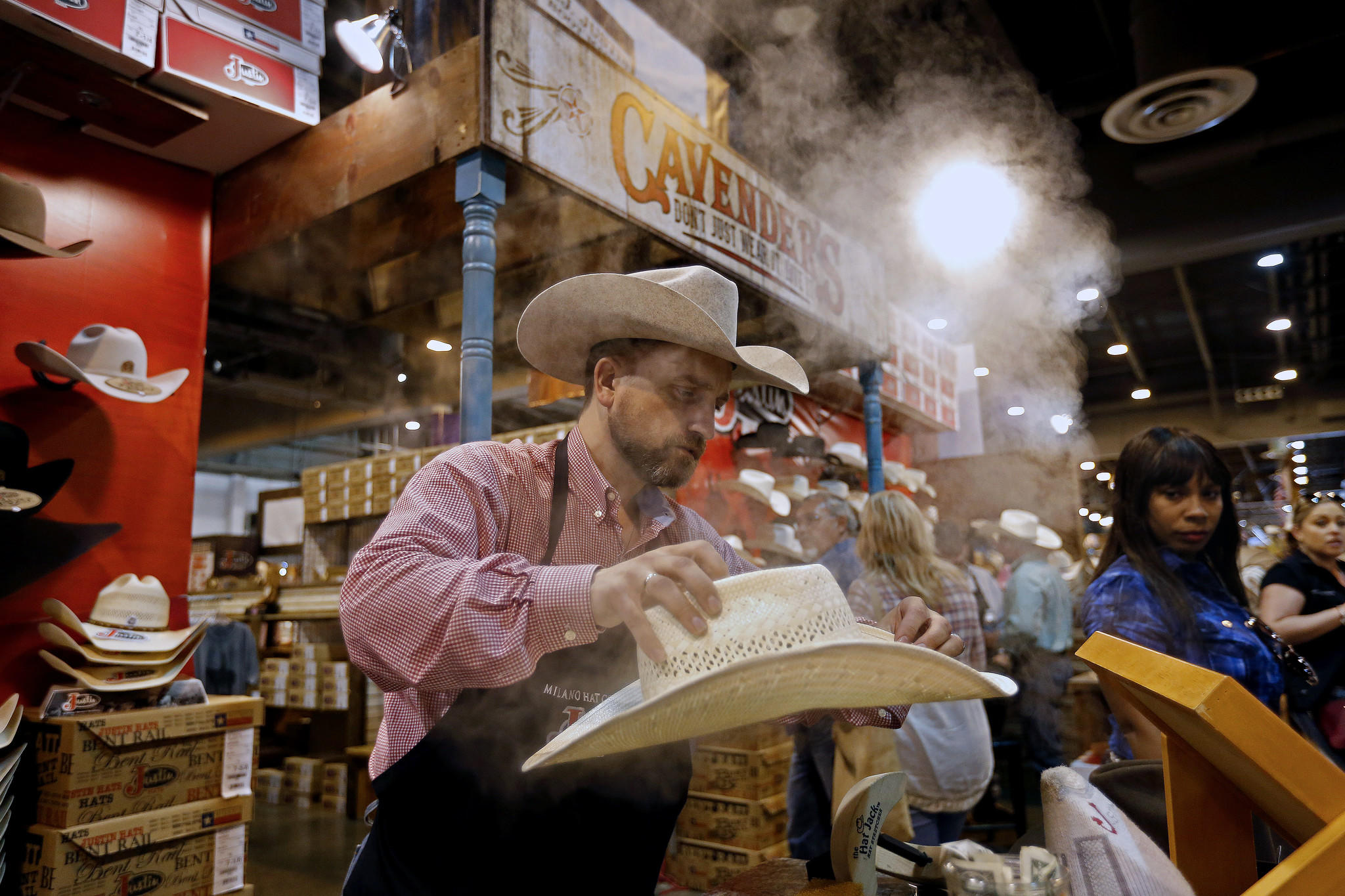 How houston has become the most diverse place in america bryan scott adjusts the shape of a cowboy hat at the houston livestock show and rodeo at nrg park in houston aiddatafo Gallery