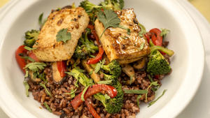 Garlic fried rice bowl with baked marinated tofu and stir-fried vegetables