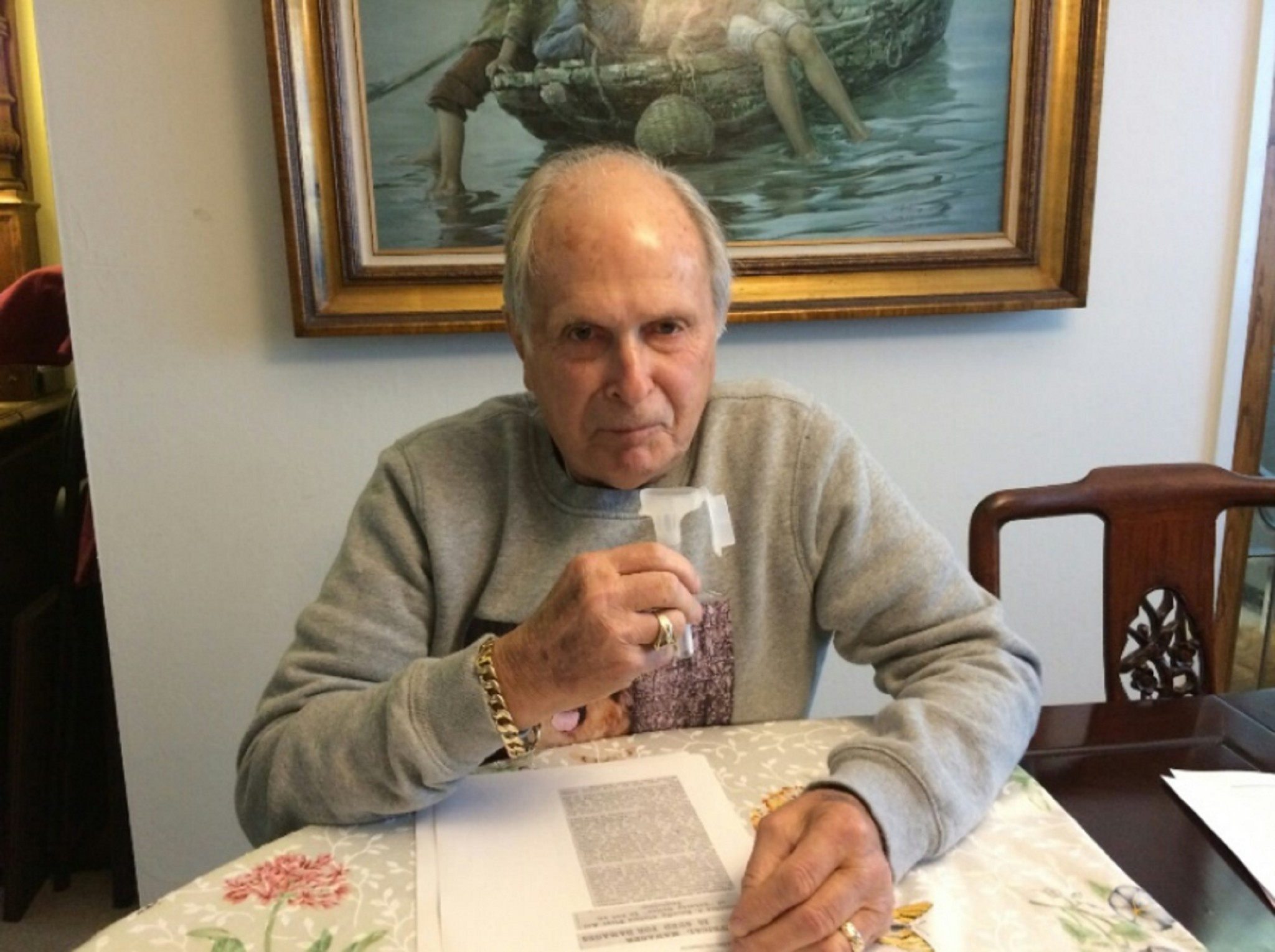 Peter Cook, 82, of San Rafael, submits saliva for a DNA test in 2016.
