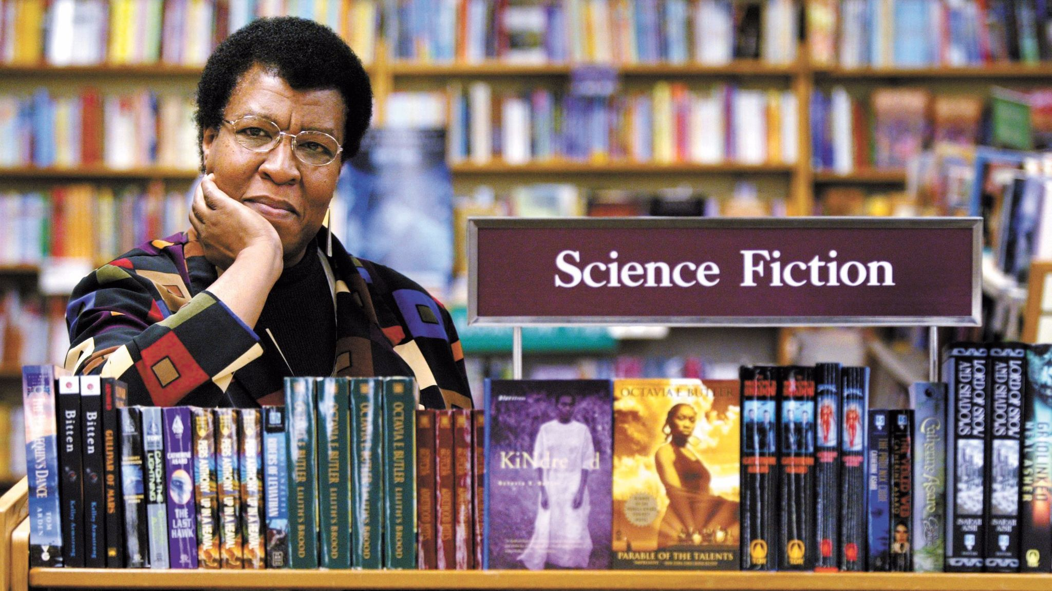 Octavia Butler is pictured in 2004 near some of her novels at a store in Seattle.