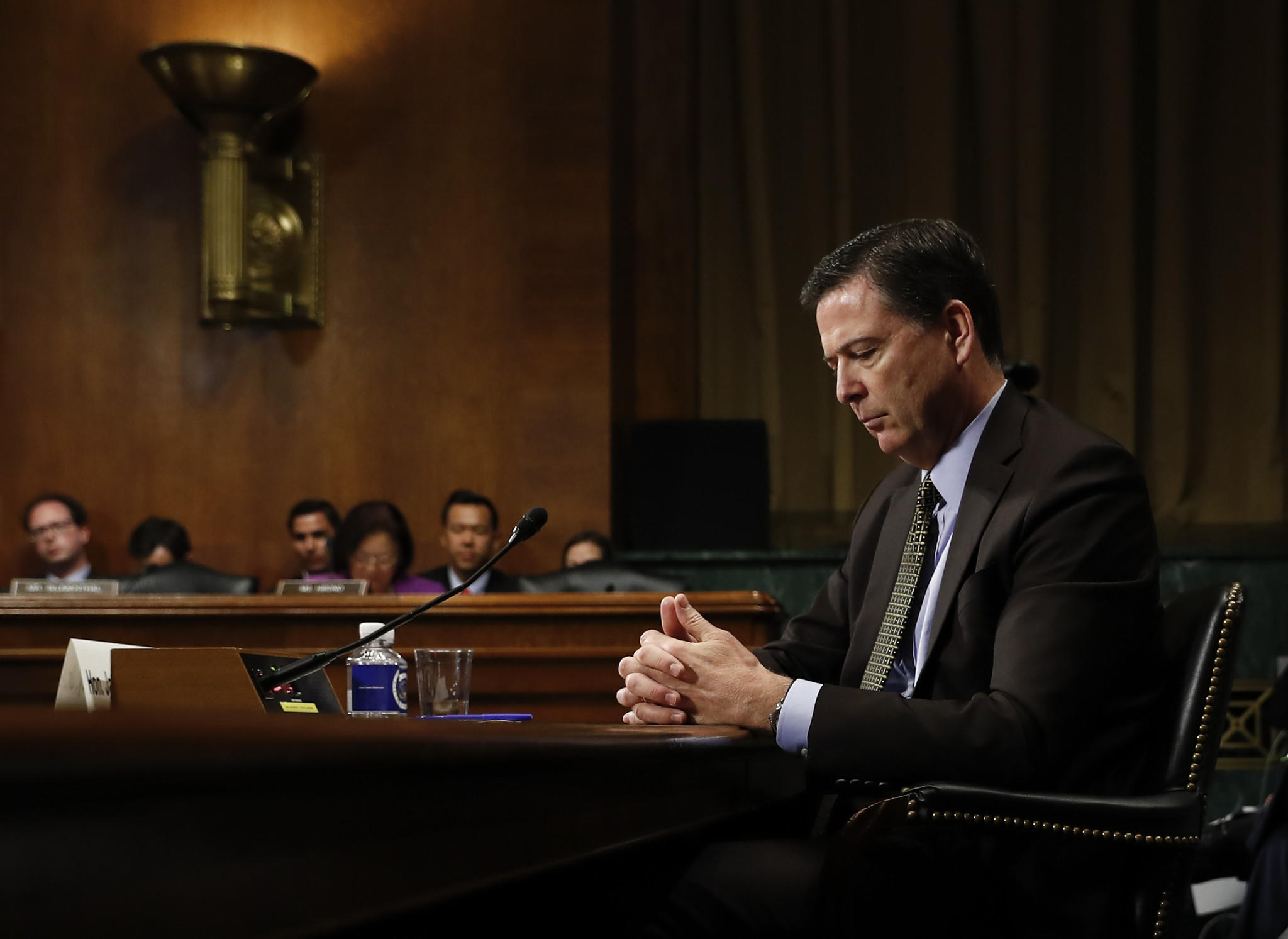 Then-FBI Director James Comey pauses as he testifies at a Senate Judiciary Committee hearing on May 3. (Carolyn Kaster / Associated Press)