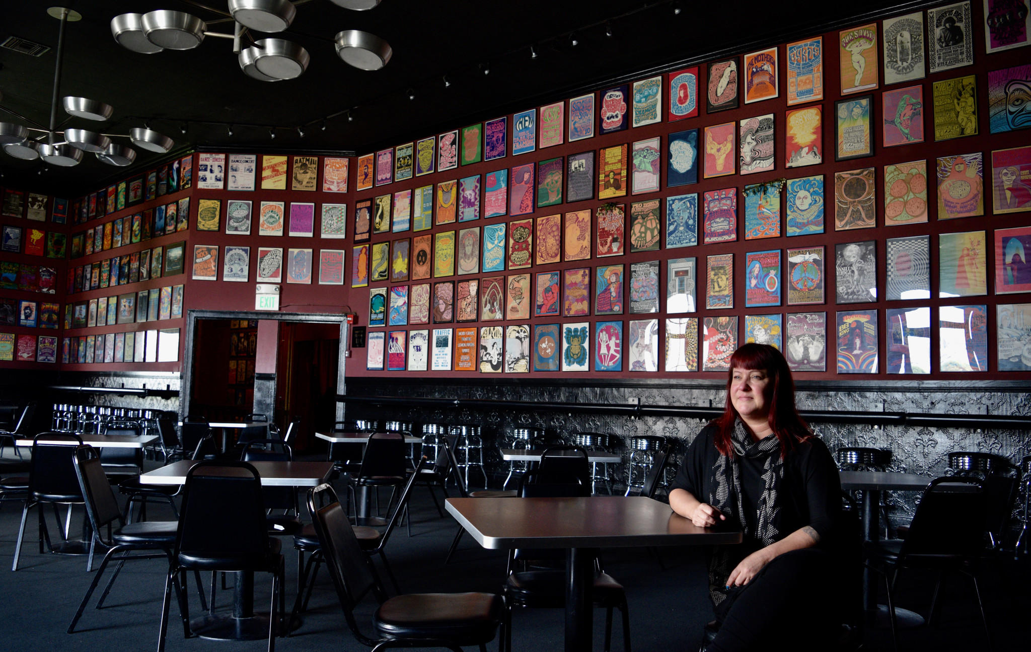 Amie Bailey-Knobler, general manager of the Fillmore in San Francisco, is shown in its Poster Room, where hundreds of concerts from over the decades are represented on the walls.