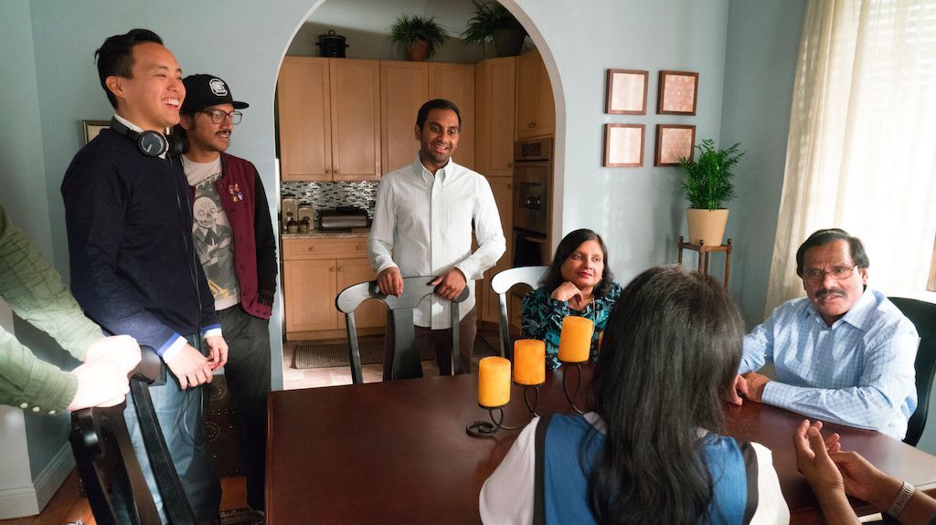 "Alan Yang, far left, and Aziz Ansari, center, during production on Season 2 of ""Master of None."""