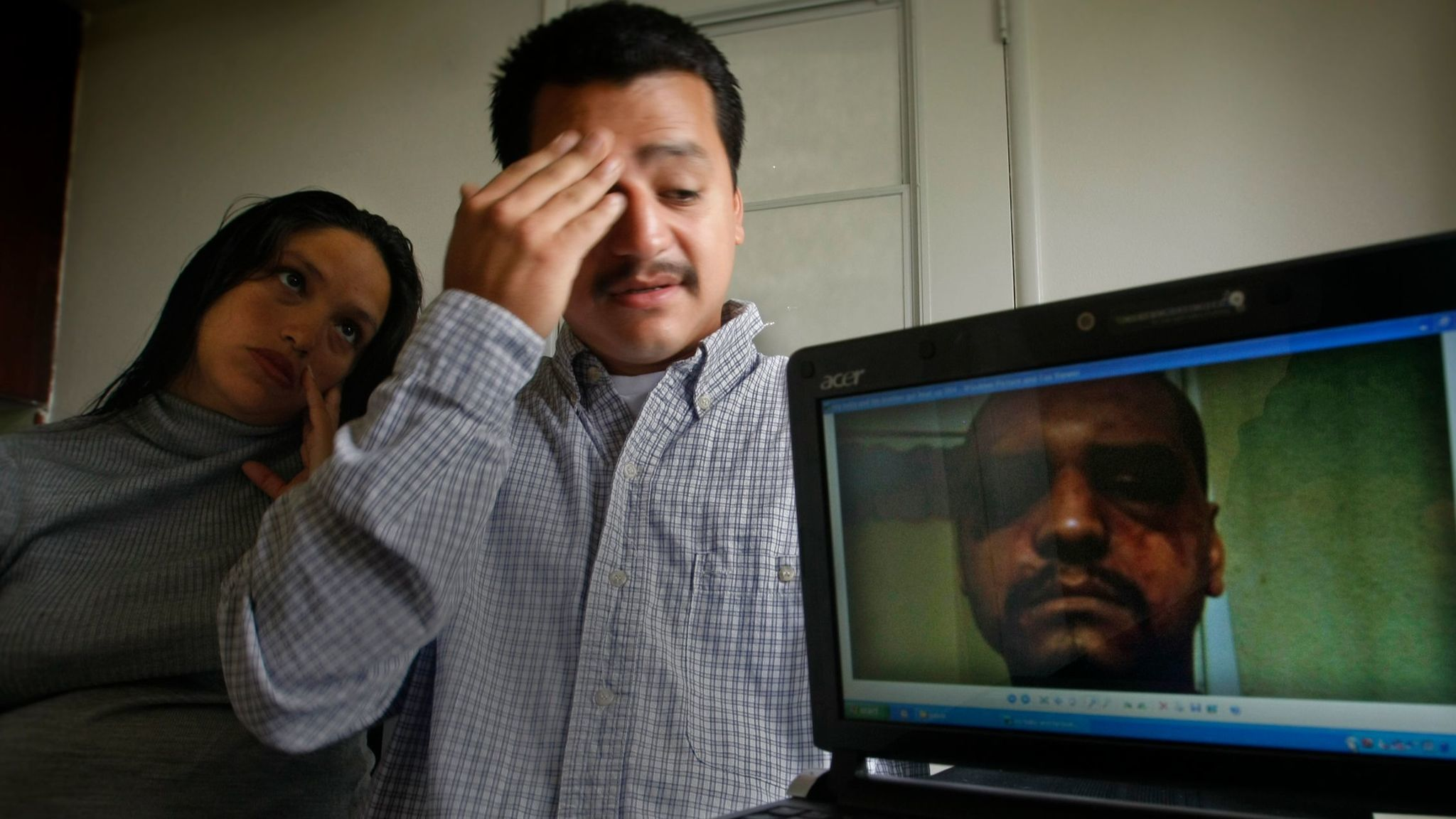 Gabriel Carrillo and his wife, Grace Martinez, with a photo she took of him after he was beaten in 2011 by Los Angeles County sheriff's deputies while visiting his brother, an inmate, at the Men's Central Jail. Federal prosecutors won convictions against the deputies.