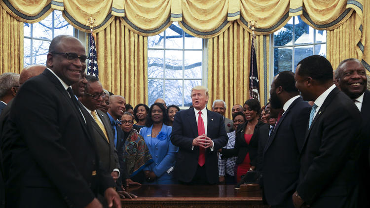 President Trump addresses officials from historically black colleges and universities in the Oval Office in February. (Aude Guerrucci / Getty Images)