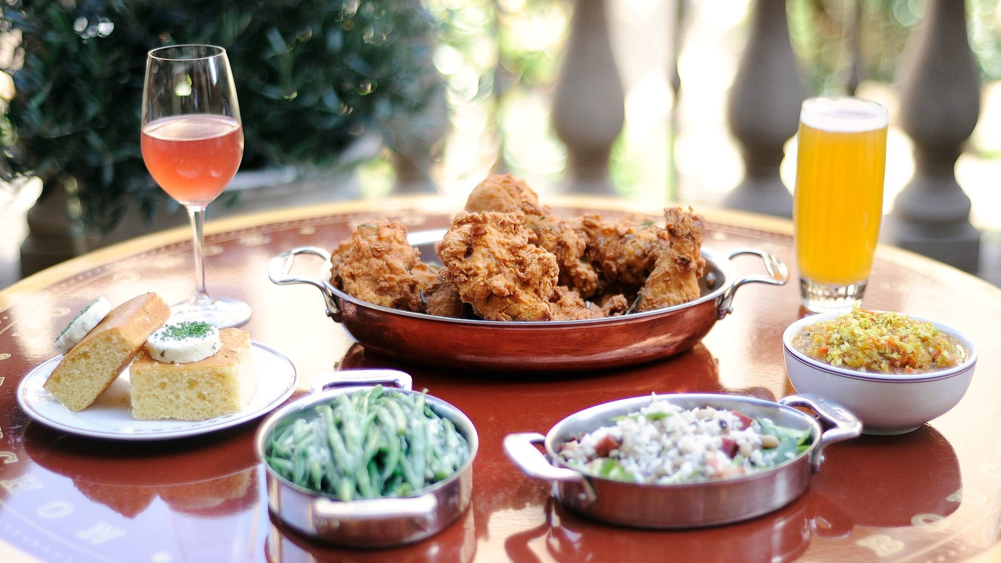 The fried chicken at Bouchon is served with weekly rotating sides.