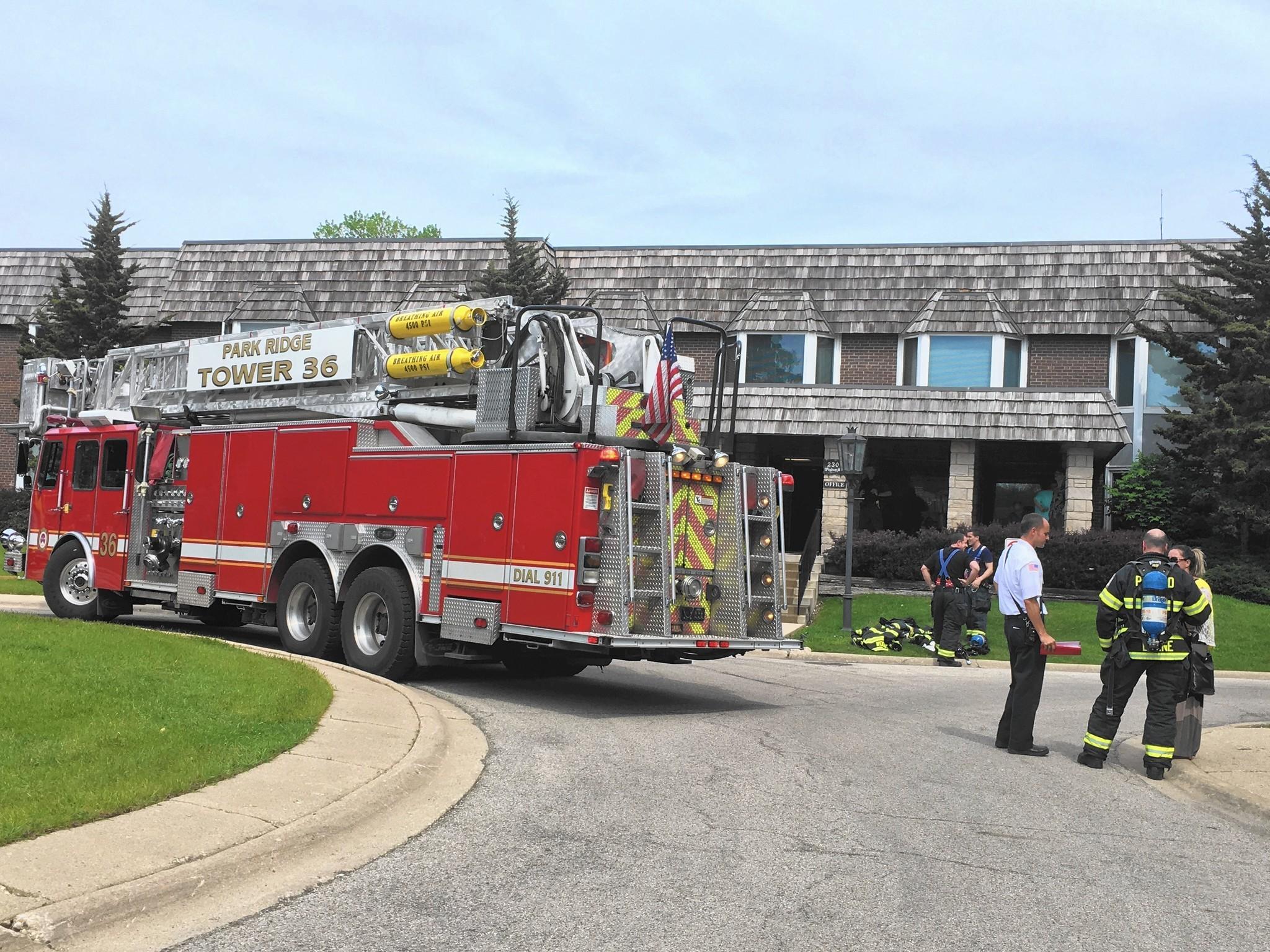 Small fire reported inside park ridge condominium building for Park ridge building department