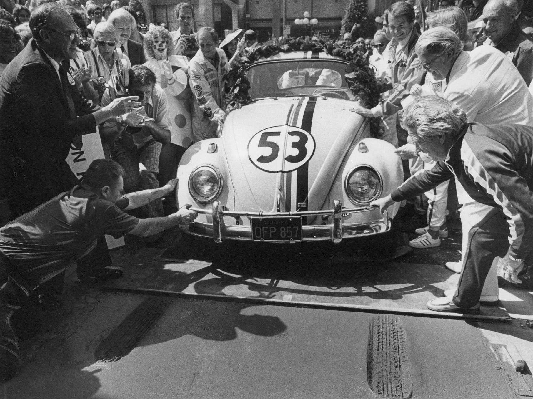 "Herbie the love bug leaves a tireprint in the wet cement at the Chinese Theatre in Hollywood for the opening of ""Herbie Goes to Monte Carlo,"" in 1977."