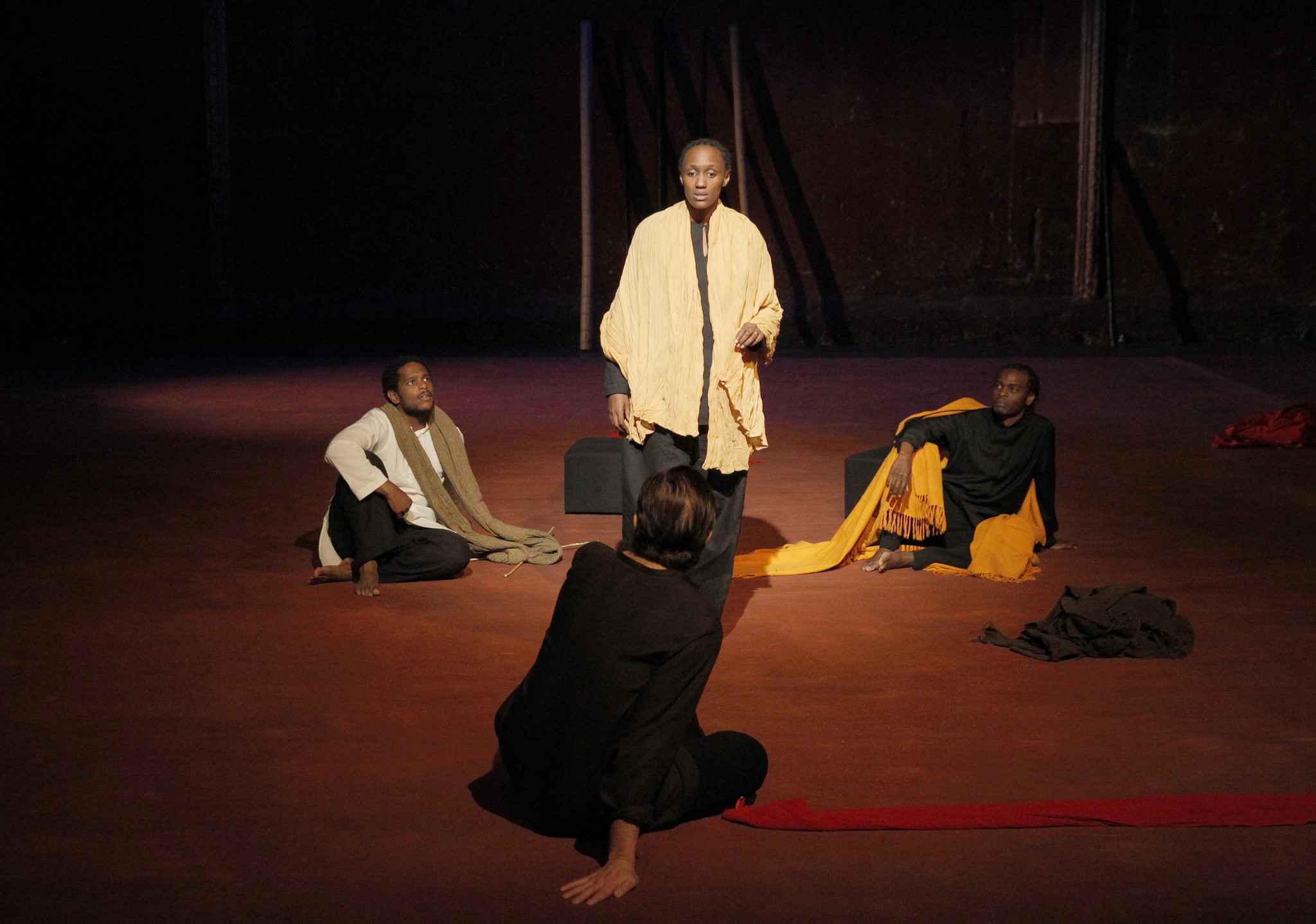 "Carole Karemera surrounded by, from left, Jared McNeill, Sean O'Callaghan and Ery Nzaramba in Peter Brook's ""Battlefield."""