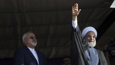 Iran's President Rouhani is the favorite in Friday's elections, but he's up against an influential conservative — and voter apathy