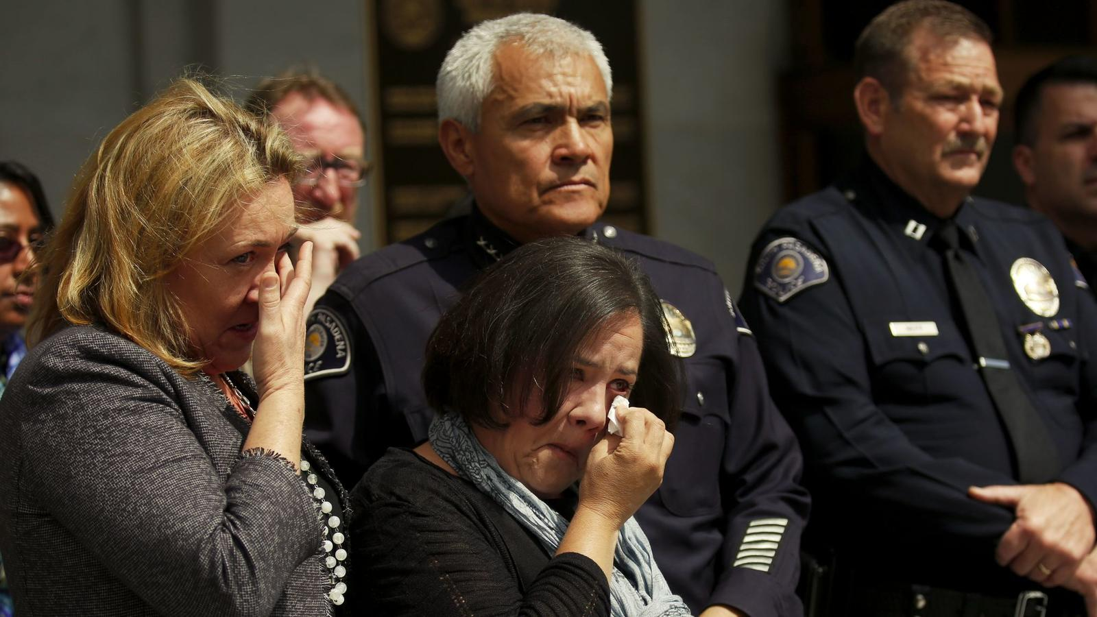 Ana Estevez, center, the mother of Aramazd Andressian Jr., wipes away tears during a news conference.