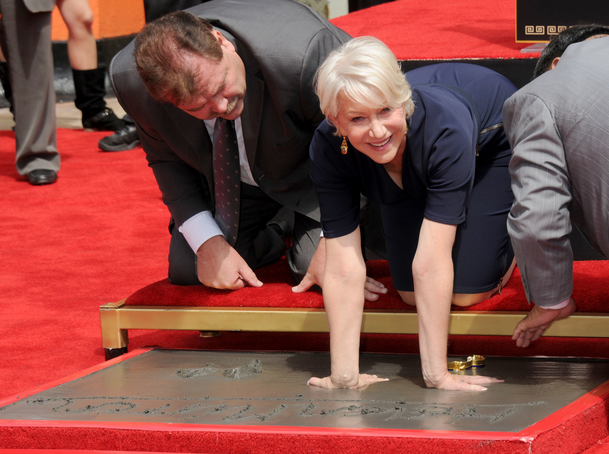 Helen Mirren gets her hand and footprints immortalized in cement at Grauman's Chinese Theatre on March 28, 2011 in Hollywood.