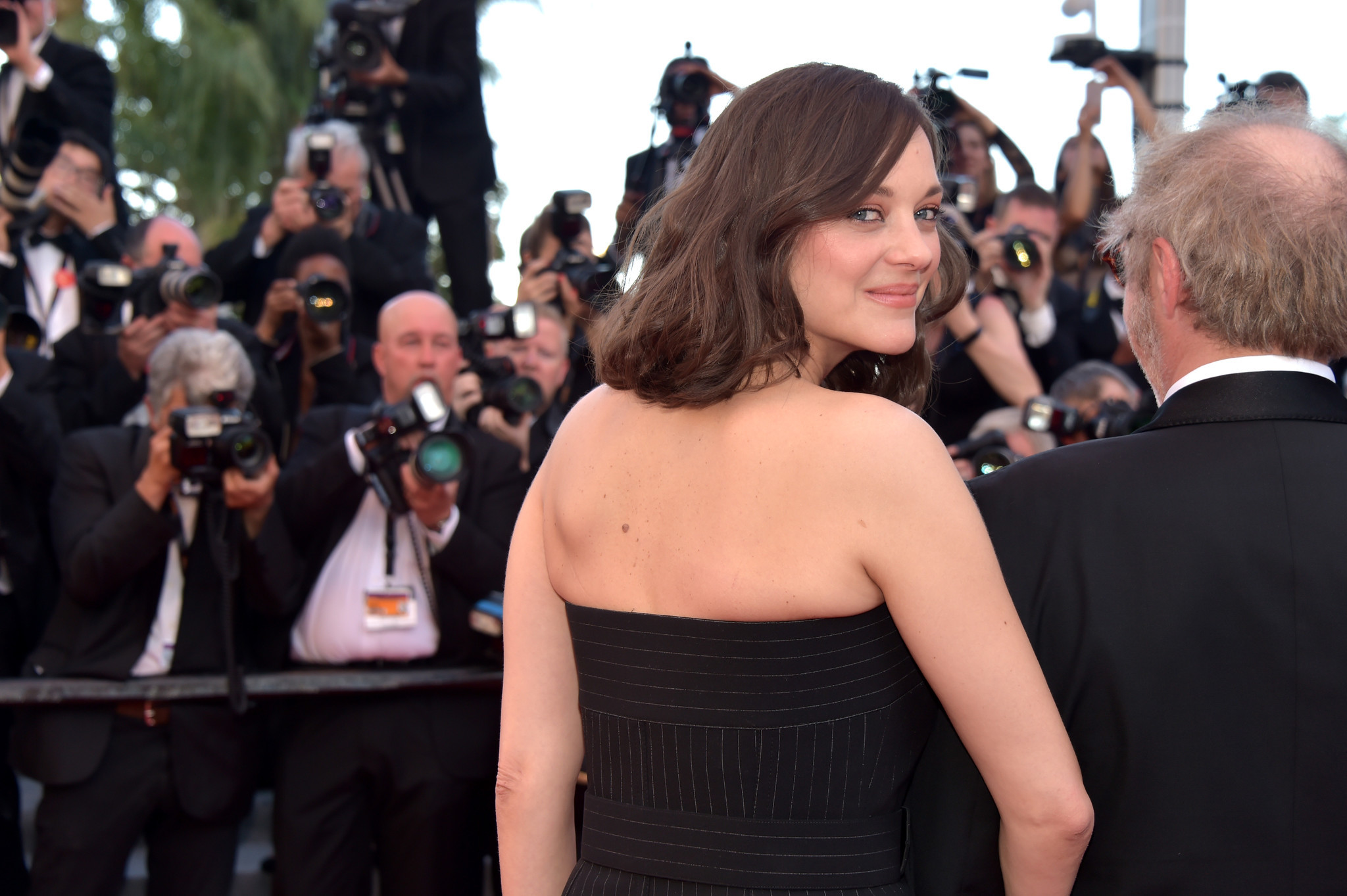 "Marion Cotillard and director Arnaud Desplechin meet the paparazzi at the screening of their ""Ismael's Ghosts (Les Fantomes d'Ismael)"" at the opening gala of the 70th annual Cannes Film Festival at Palais des Festivals."