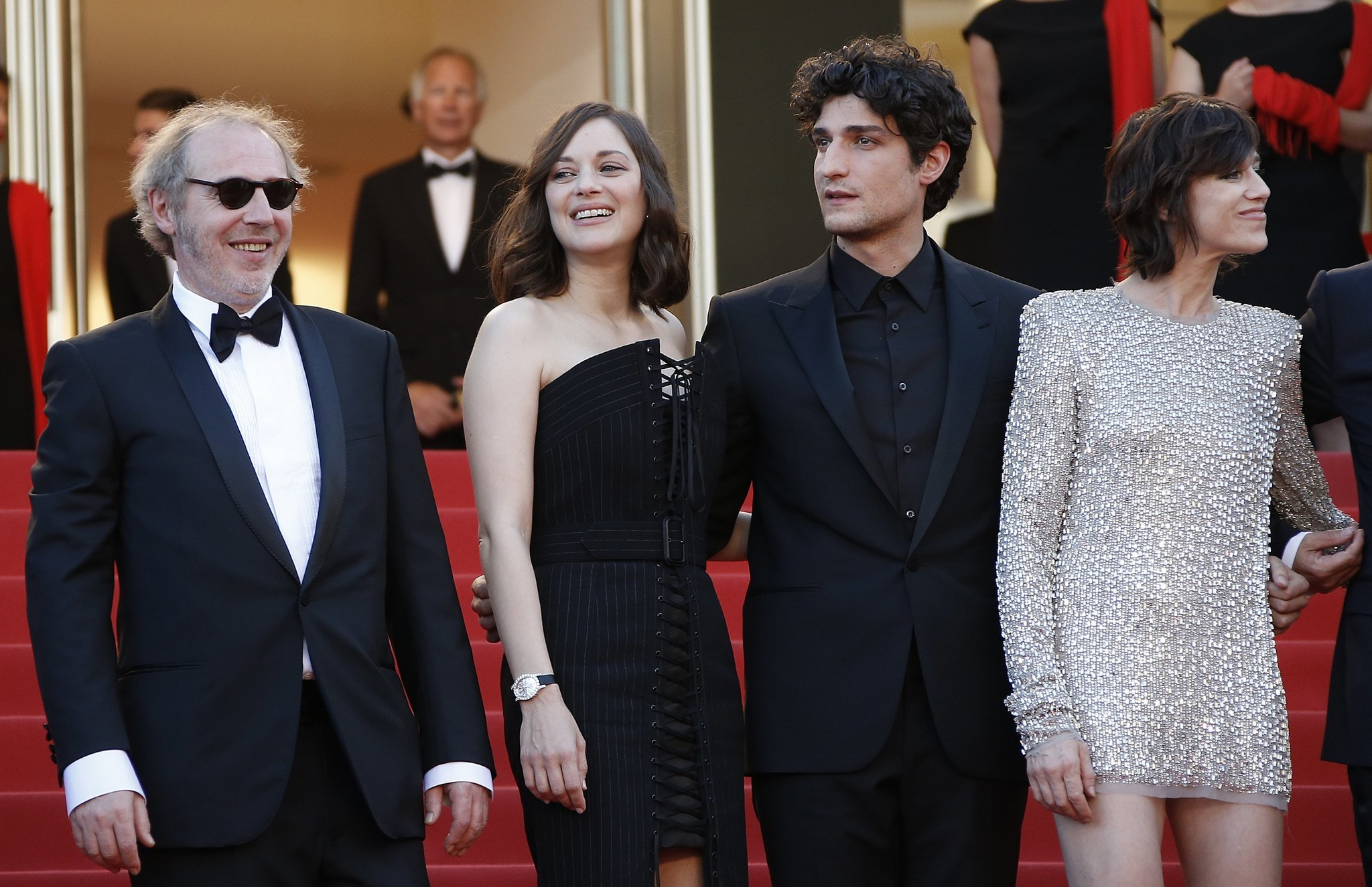 "French director Arnaud Desplechin, left, with actors Marion Cotillard, Louis Garrel and Charlotte Gainsbourg arriving for the opening gala screening of ""Ismael's Ghosts (Les Fantomes d'Ismael)"" at the 70th annual Cannes Film Festival. MORE PHOTOS"