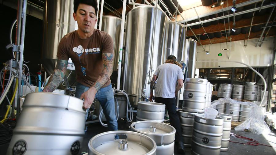 Jason De La Torre head brewer at Oceanside Mason Ale Works in Oceanside, prepares kegs for cleaning.