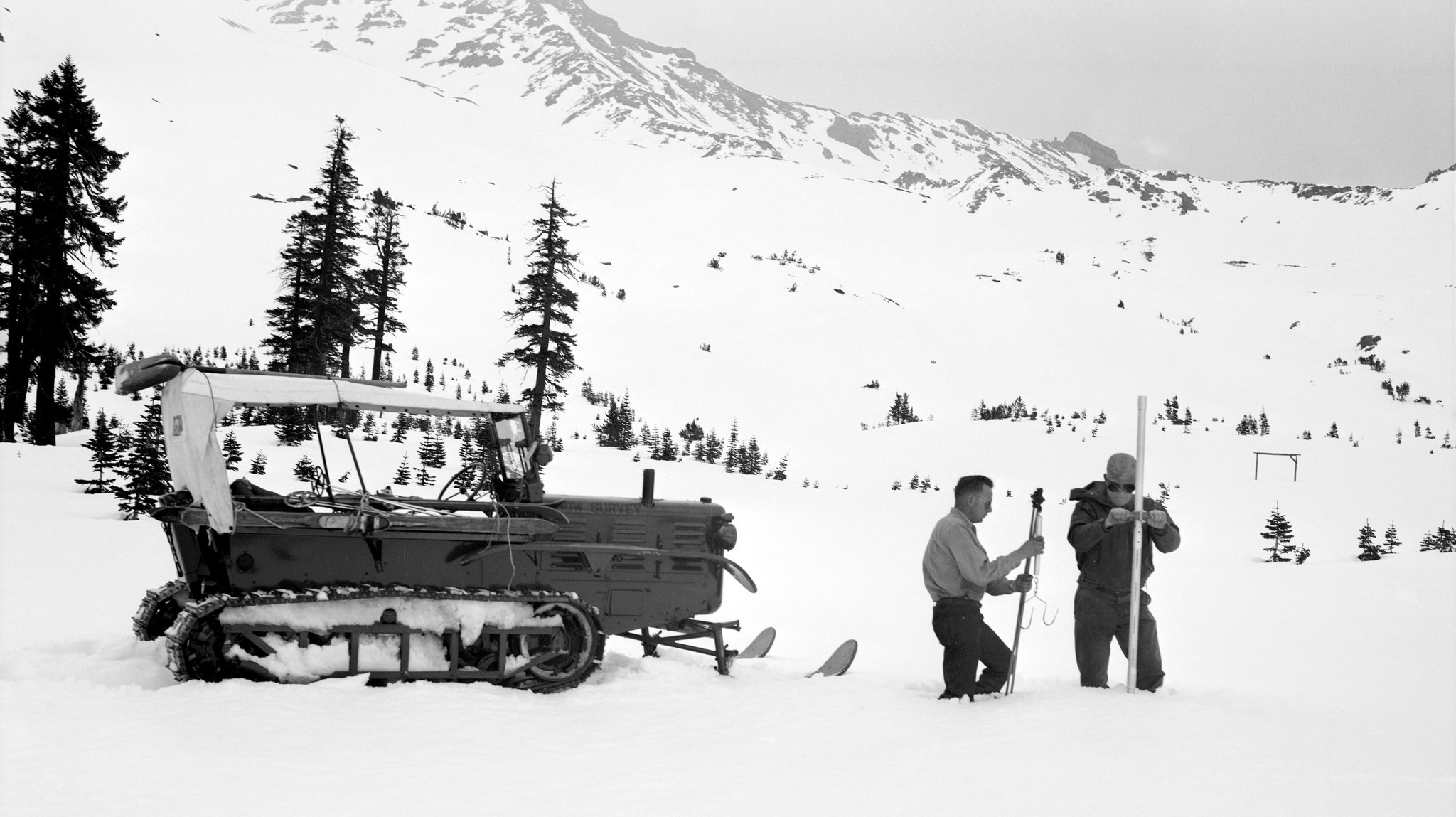 California Department of Water Resources workers conduct a Sierra snowpack survey in El Dorado County in 1958. The measuring methods haven't changed much since then.