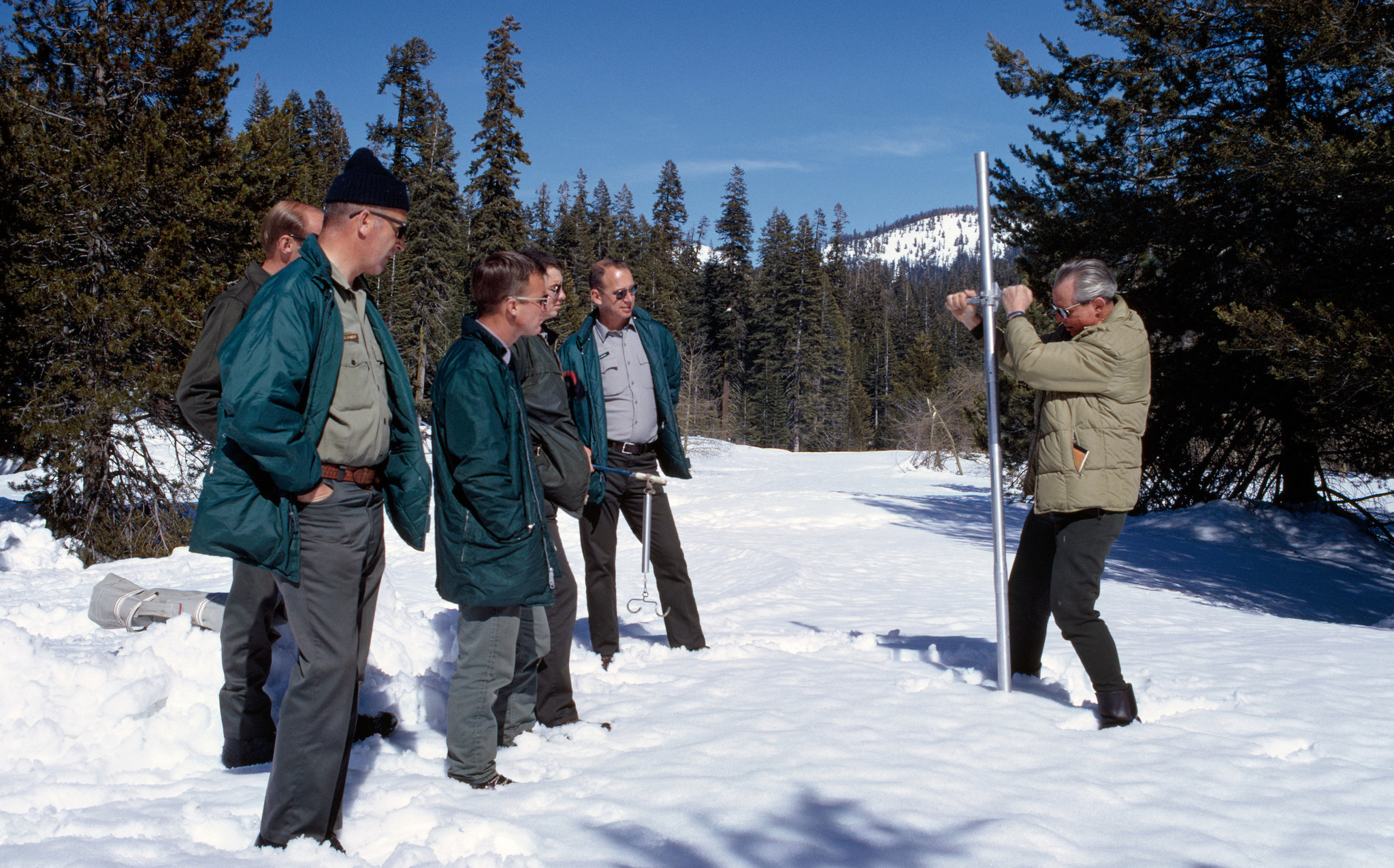 Ned Peterson, right, of the California Department of Water Resources demonstrates how to use the snowpack sampler during a snow survey class in 1969.